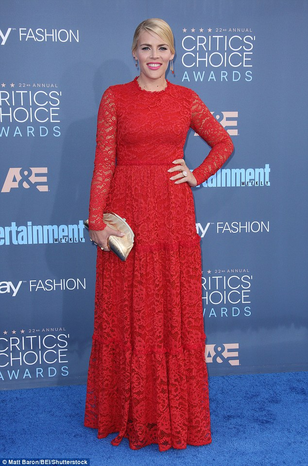 Lady in red: Busy looked beautiful in a floor-length sheer red lace gown, which she paired with a cute gold clutch