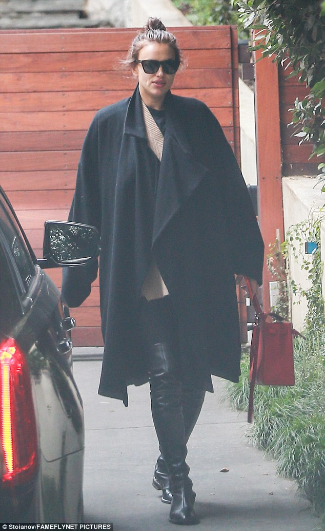Bundled up: Irina Shayk covered up while leaving Bradley Cooper's home in Los Angeles on Sunday amid rumours they are expecting