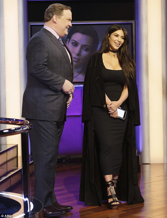 Picture perfect: Kim was sporting an all-black outfit with neutral make-up for the occasion