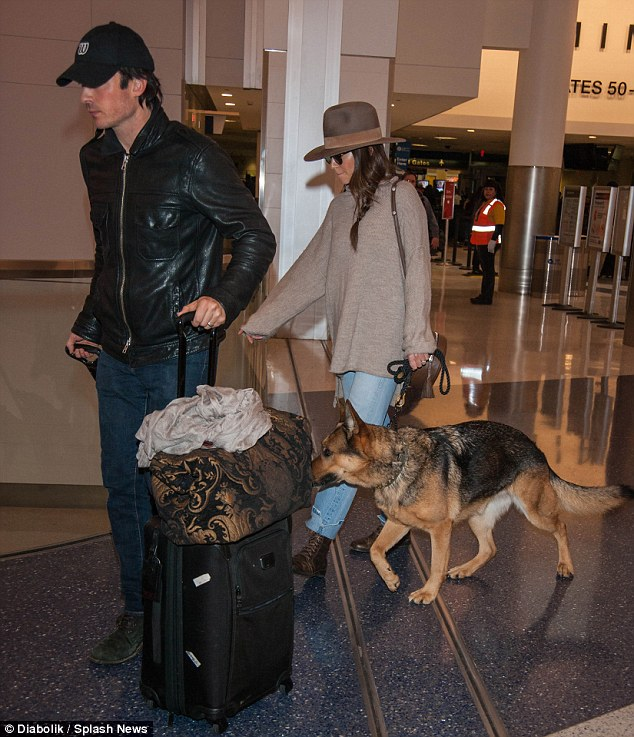 Decade age difference: The Louisiana-born heartthrob hauled their two luggage trolleys as the 28-year-old LA native escorted their pet dog through the terminal