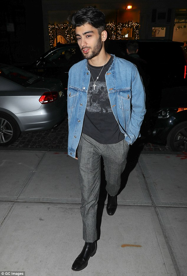 Friends: While Zayn - who famously fell out with Louis following his departure from 1D - remained absent at the appearance, he did take to Twitter on Friday to pen his support