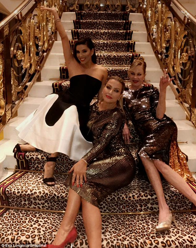Why not? The women couldn't help but snap a picture on the cheetah-print staircase