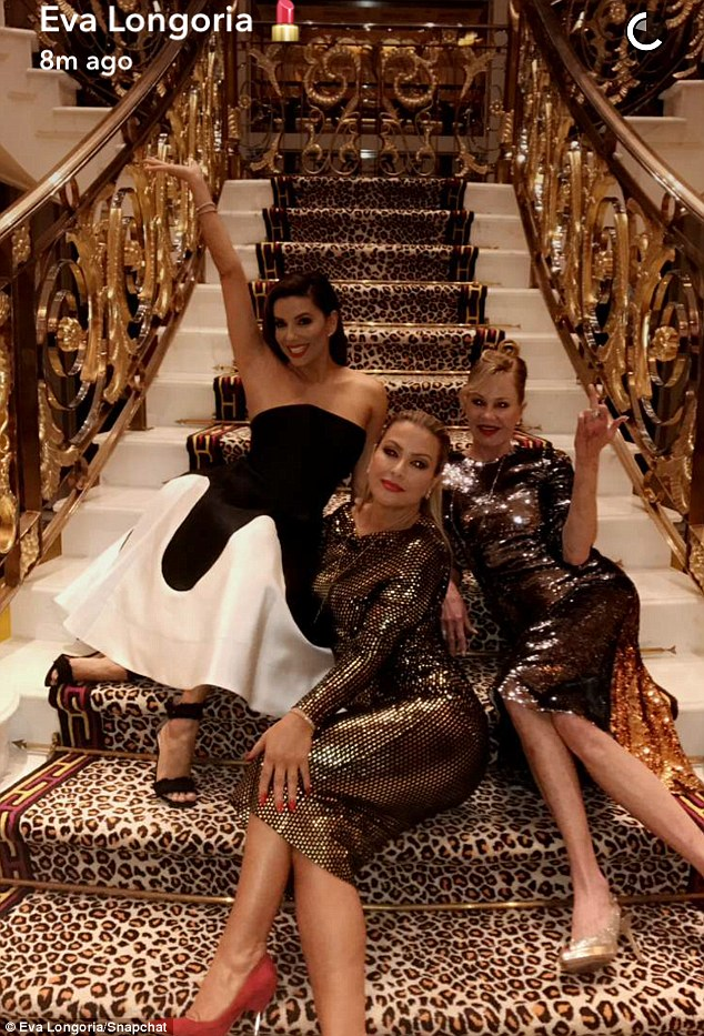 Lavish luxury:Eva posted this Snapchat of herself, Melanie and Anastacia reclining on the grand staircase of their opulent hotel on Sunday