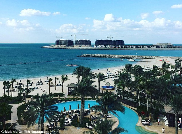 Life's a beach: Melanie couldn't resist sharing this view  from her hotel, playfully captioned , 'Doobe doobe DUBAI'
