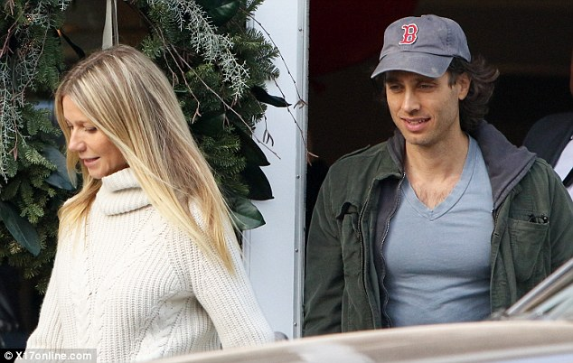 Sports focused: Brad, who sported a Boston Red Sox baseball cap, still stayed to his girlfriend