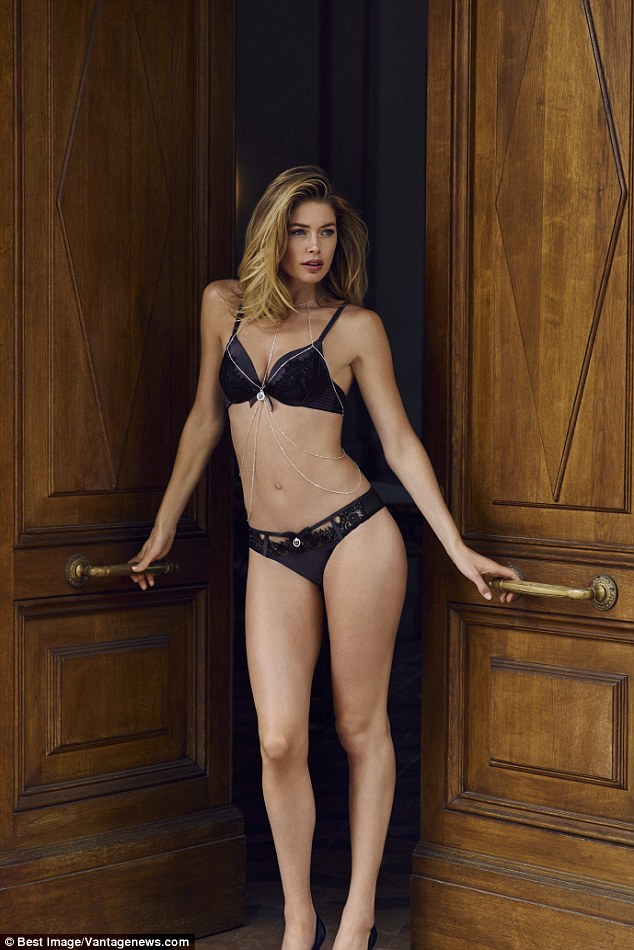 Hello boys: A second shot finds Doutzen in an equally revealing state while modelling a bold blue variation with intricate chain embellishments