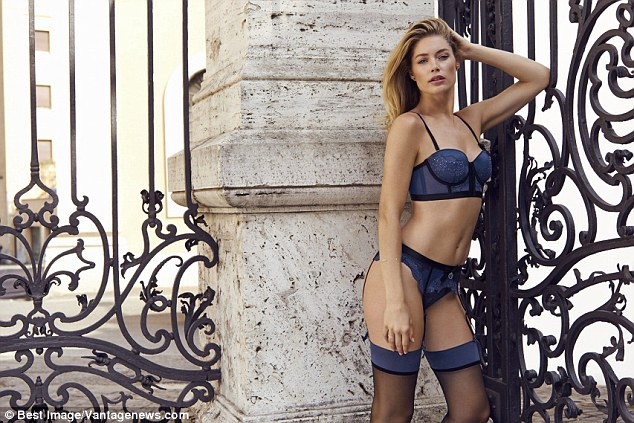 The bold and the blue-tiful: Doutzen ends the set in a midnight blue two-piece teamed with sheer black stockings and suspenders
