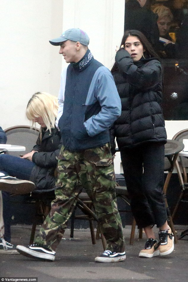 Eclectic style:Wrapping up for their outing, Rocco displayed his typically eclectic fashion sense as he sported a camouflage pair of loose-fitting pants with a navy and blue jacket around his frame