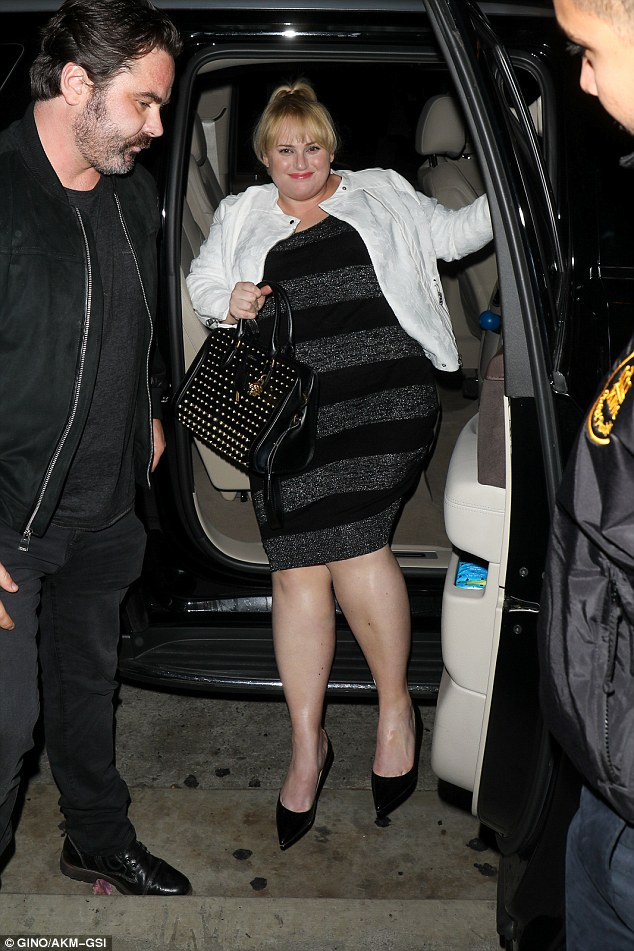 Night on the town:Rebel looked dolled up for the evening and wore her frock with a white jacket and black pointed flats