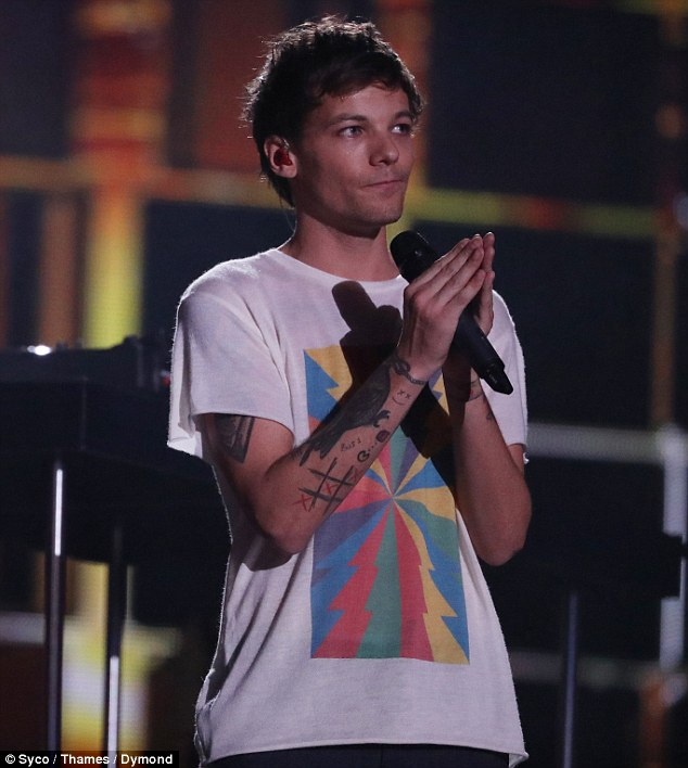 Chart topper: Louis Tomlinson's debut single has topped the iTunes charts following his emotional performance on Saturday evening's edition of The X Factor
