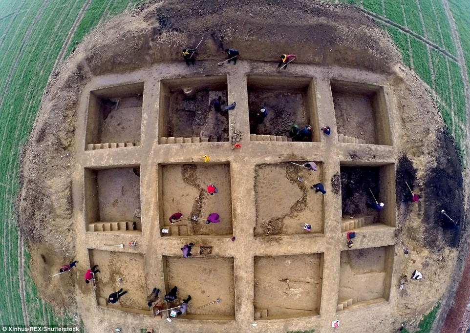 Tracing history: Chinese experts have started unearthing the ruins of Bairen, an ancient trading city that was wiped out by floods. The above picture shows staff members working at the site on December 8