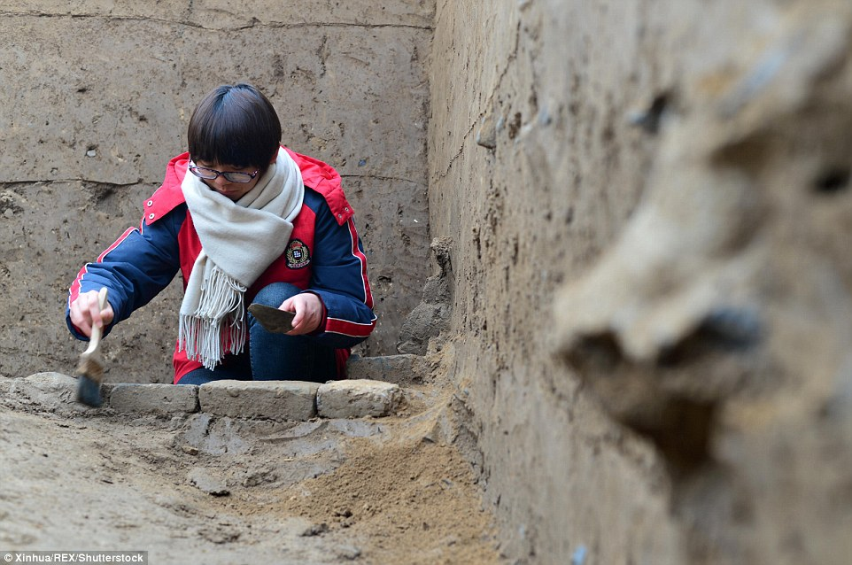 Bairen is thought to have been a prosperous trading hub until its sudden disappearance about 1,400 years ago in China's Tang Dynasty.The above picture shows an archaeologist working at the site on December 8