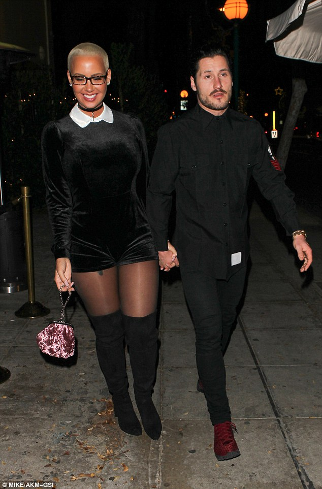 Black on black: Heading for a date night at popular restaurant Delilah, the duo were sartorially in sync