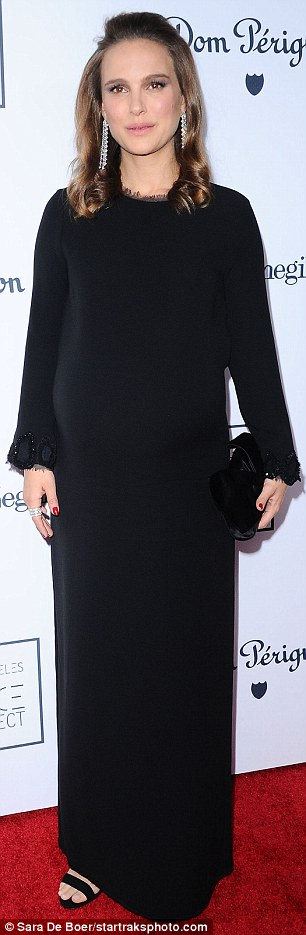 Chic: The 35-year-old had donned a flowing black dress that minimised the bulging bump indicating her second pregnancy