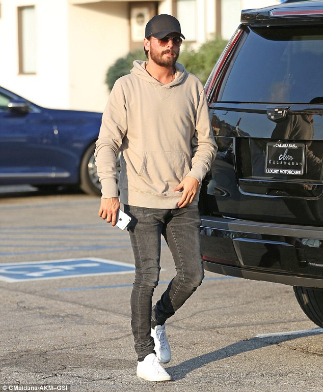 More mature?'Scott has been amazing to Kourtney, and she is very happy,' added the source (pictured on Monday)