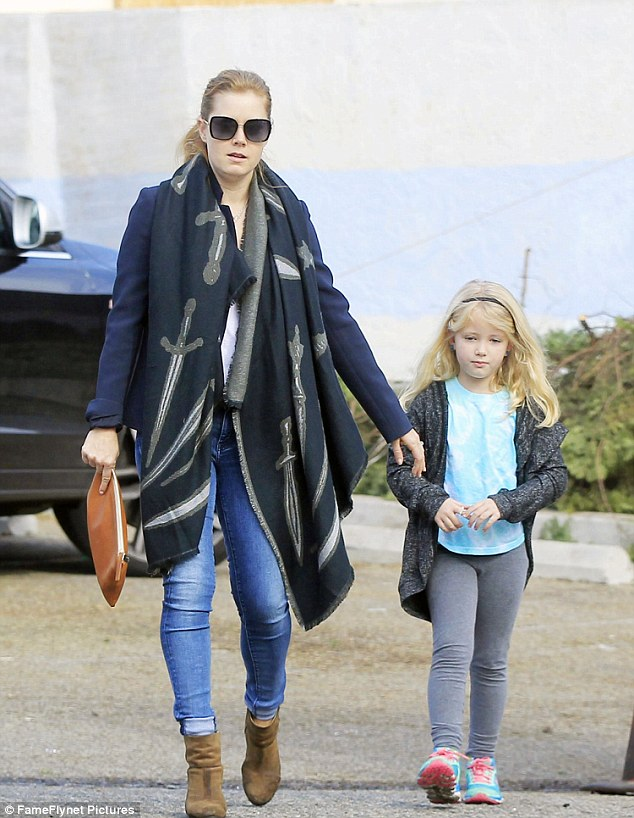 Time to decorate! Amy Adams went Christmas tree shopping with her daughter Aviana on Saturday