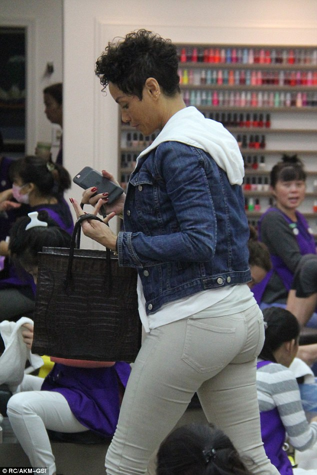 Leggy display: Her long pins were perfectly displayed in tight-fitting stone-coloured jeans