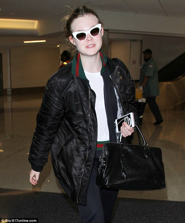 She paired her luxurious airport look with pulled back hair and vintage inspired sunglasses; seen on Thursday at LAX