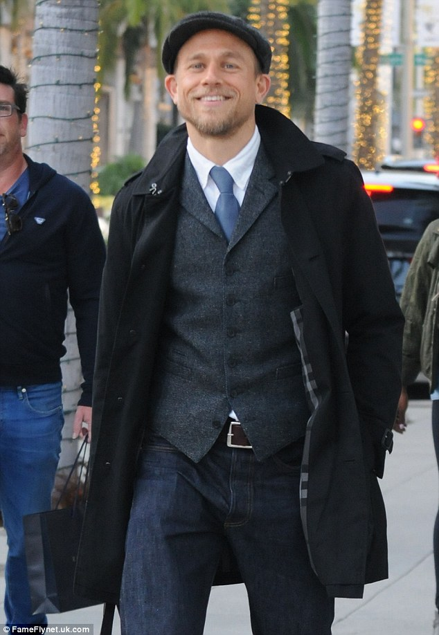 Dapper: The 36-year-old beaming actor was seen leaving the Prada store in a waist coat with a button up shirt and tie