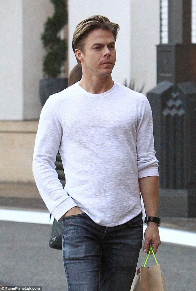 Well-deserved: Derek Hough, 31, takes some time off on Friday for holiday shopping after months of rehearsals for Hairspray Live!