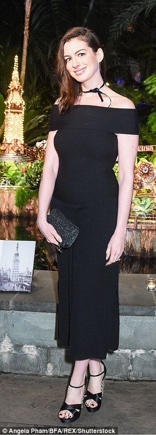 Leggy: And flaunting her toned physique in a figure hugging Bardot dress, she accentuated her stature in studded platform sandals