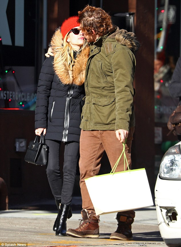 Smitten: Emma Roberts, 25, and Evan Peters, 29, said goodbye to their tumultuous past as they put on a loved-up display while heading out for a shopping trip in New York on Friday