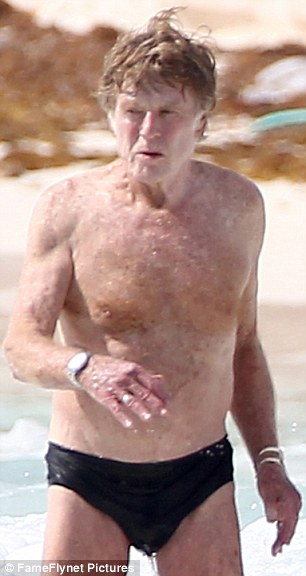 Age defying: Robert Redford defied his age as he took a dip in the sea off the coast of Mexico on Friday, not afraid to show off his body in a pair of small black swimming trunks