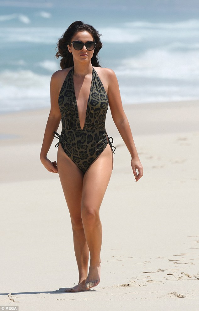 Showing her wild side! Vicky Pattison, 29,showed off the fruits of her fitness labours last week as she stripped to a raunchy swimsuit for a day at the beach in Australia