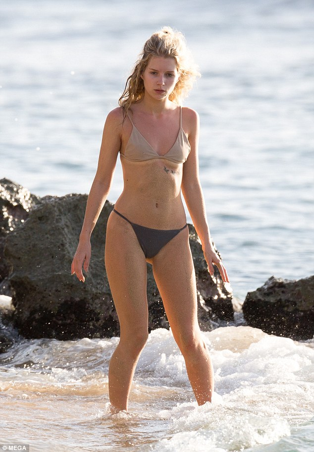 Model behaviour: Lottie Moss showed just why he is so besotted with her as she hit the beach in Barbados on Saturday
