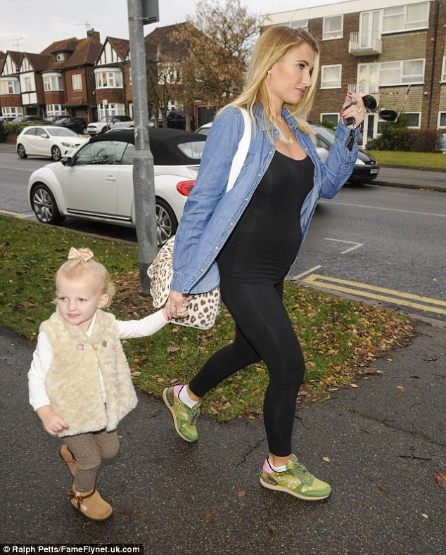 Errands: The pregnant TOWIE star, 26, who shares 2-year-old Nelly with fiancé Greg Shepherd, 31, showed off her blossoming baby bump as she ran errands with the tot