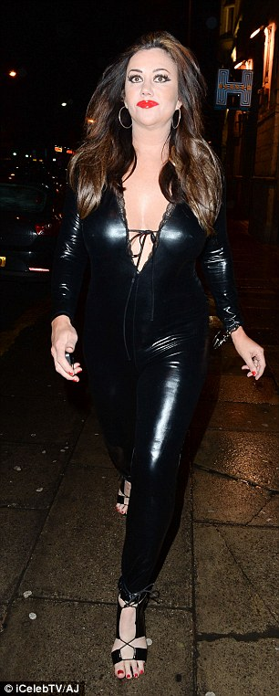 Racy! The former reality star, 48, poured her curves into a low-cut skintight PVC catsuit as she hit the town for a night out
