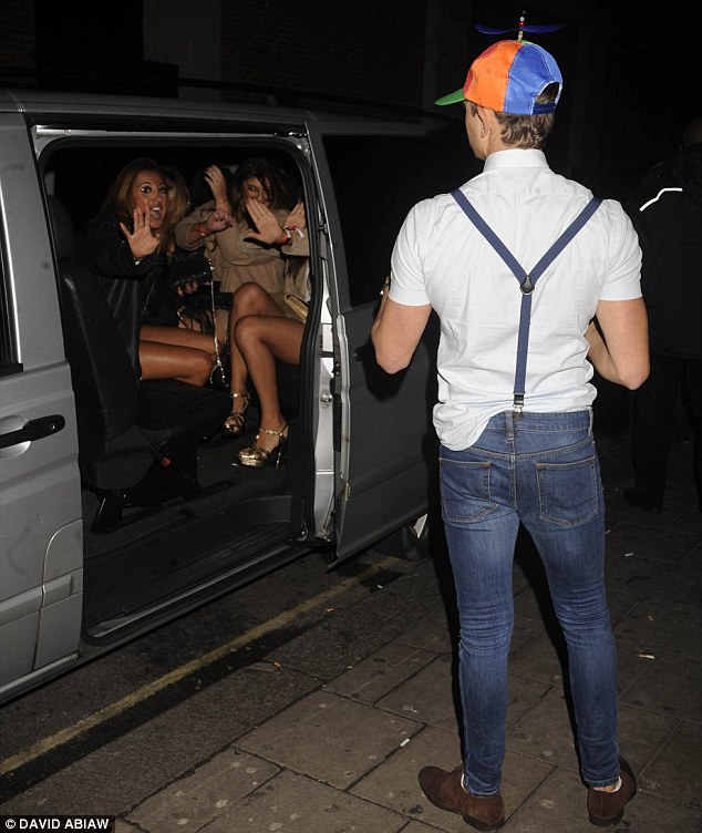 Ladies' man: George seemed keen to hop into a taxi carrying a bevy of beautiful women