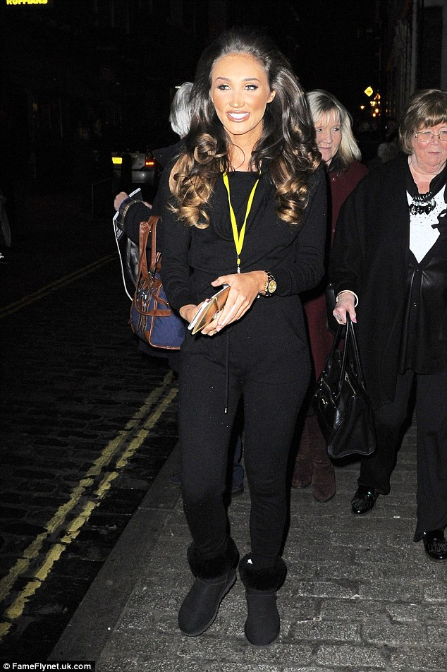 Debut: Megan McKenna looks ecstatic as she leaves the Adelphi Theatre after making her West End stage debut in stunning satin gown alongside Gleb Savchenko