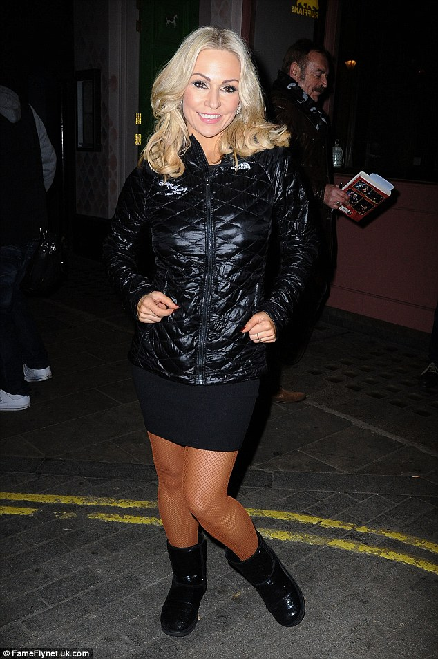 All wrapped up: Kristina later slipped into a black minidress and puffa jacket