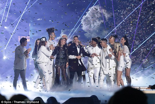All the gang back together: All the finalists rushed onto the stage to cuddle Matt after hearing his news
