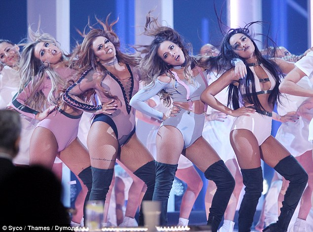 Special occasion: Newly single Jesy Nelson thrills fans in tiny leotard as she joins Little Mix bandmates for X Factor finale performance... exactly 5 years since they took home the crown