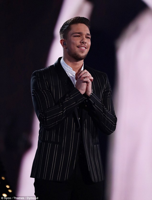 Winner, winner: Matt Terry was crowned winner of The X Factor on Sunday, and will release a track called When Christmas Comes Around