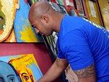 Passionate: Sukumaran took up painting 2010. He now runs an art studio at the jail. Here he is seen painting on a canvas at the prisoners studio