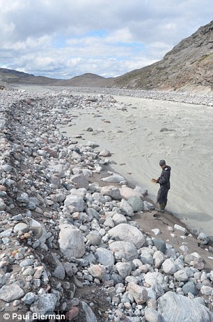 Sampling sand from the headwaters of the Watson River where it emerges as an outwash stream from the margin of the Greenland Ice Sheet near Kangerlusuaq