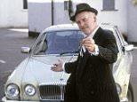 TELEVISION PROGRAMME: 'MINDER'..ACTOR, GEORGE COLE, AS  CAR SALESMAN ARTHUR DALEY, WITH  JAGUAR XJ6 MOTORCAR.......ARTHUR DALEY..CAR..CAR DEALER..TV SHOW..BARRY BRECKON
