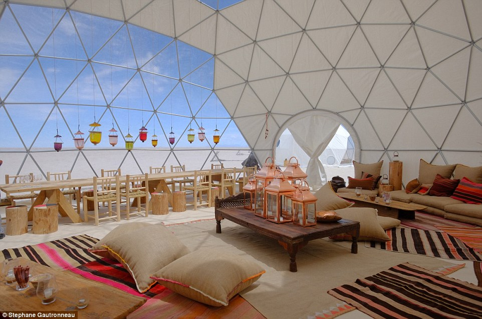 Before their trip glampers can decide on the layout of their tent and if they'd like a separate kitchen, lounge, dining tents and a hot tub at the site, too. Pictured is a dome tent decorated with local furnishings at Uyuni salt flats in Bolivia
