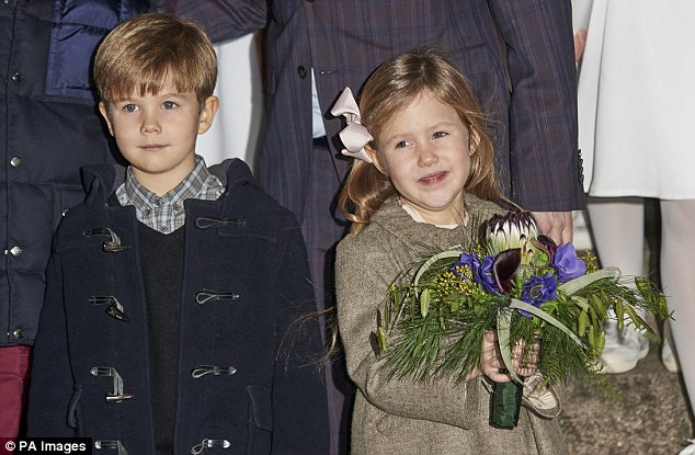 Adorable: Prince Vincent and Princess Josephine, both five, are pictured outside the church