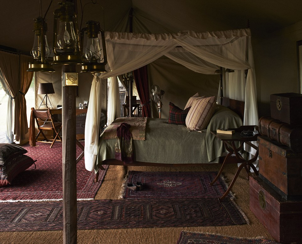 Where the wild things are: Just nine tents lie in the Great Migration path of a 350,000-acre private game reserve. Each tent is decorated with Persian rugs, antique mahogany and other luxury touches