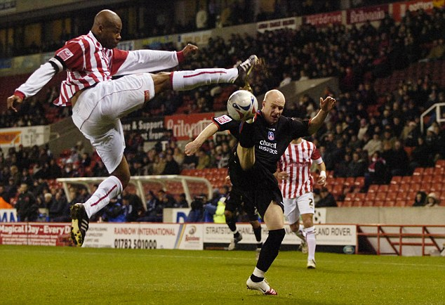 Crystal Palace striker Andy Johnson tries to take evasive action as Duberry jumps across to make a tackle during Stoke's 3-1 home defeat by the Eagles in March 2006