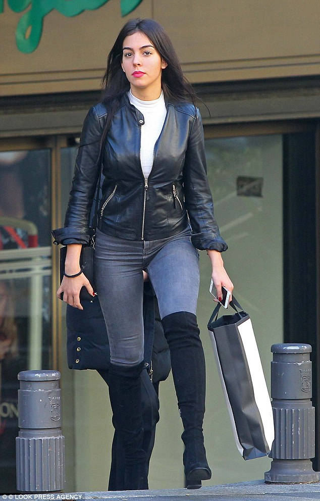 Biker chic! Cristiano Ronaldo's girlfriend Georgina Rodriguez steps out for a spot of shopping in Madrid with a male pal in a slick leather jacket and grey skinny jeans