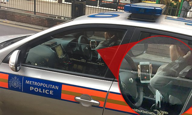 Officer caught chatting on mobile with no hands on the steering wheel in North London