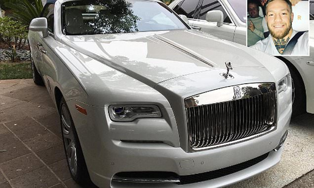 Conor McGregor and pals 'stuffed' in a Rolls Royce as UFC star takes motor for a spin