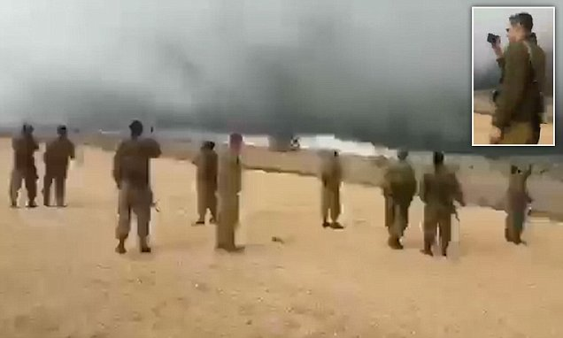 Syrian border between ISIS and Israel sees dust and rain cloud barrier