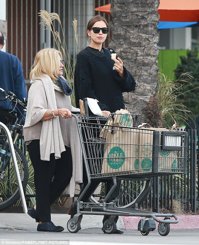 Trolley dollies: Model Irina Shayk went grocery shopping with boyfriend Bradley Cooper's mum Gloria Campano on Monday in Los Angeles as pregnancy rumours continue to swirl