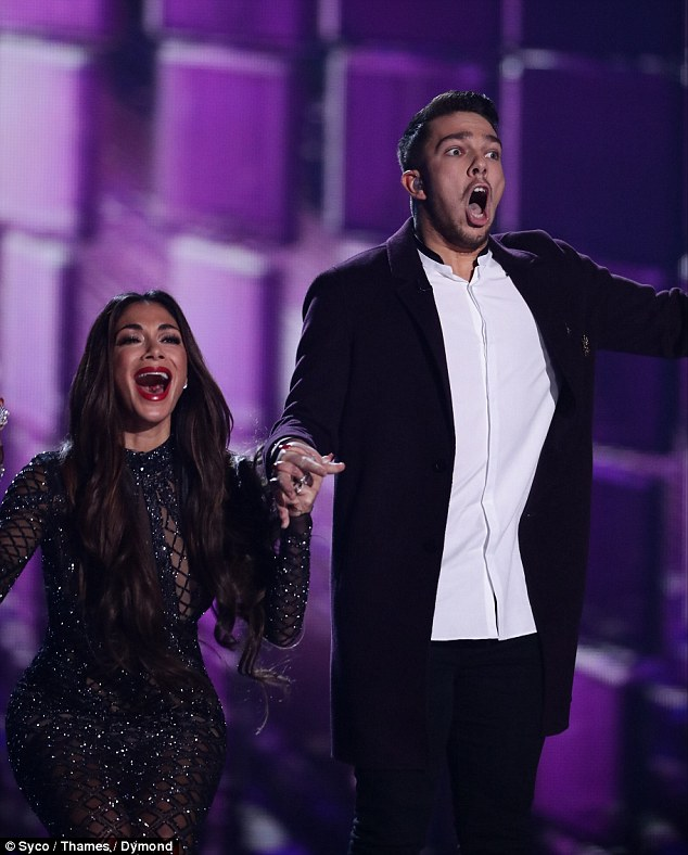 Disbelief: Matt was left astounded as he discovered he had beat fellow hopeful Saara Aalto, 29, after the duo battled it out in the live show in Wembley Arena